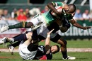South Africa's Lubabalo Mtembu is taken to the ground