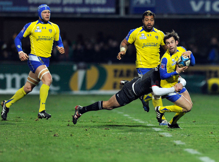 Clermont's Morgan Parra is wrapped up by Byron Kelleher