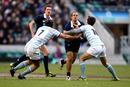 Oxford's Luke Fenwick crashes into the Cambridge defence