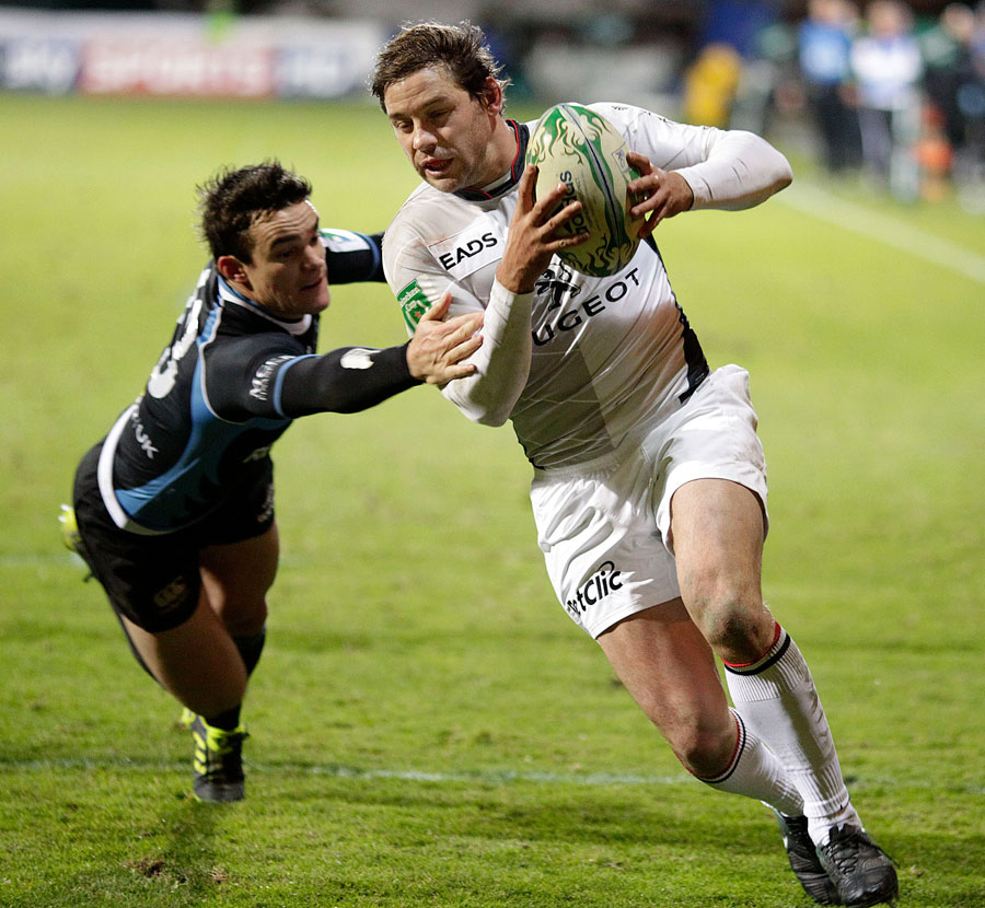 Toulouse wing Cedric Heymans evades Max Evans to score in the corner