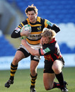 Wasps' Ben Jacobs is tackled by Dragon's Patrick Leah