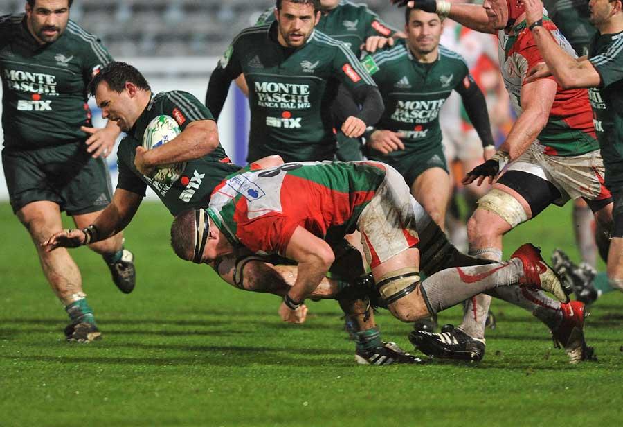 Biarritz' Imanol Harinordoquy tackles Aironi's Simone Favaro