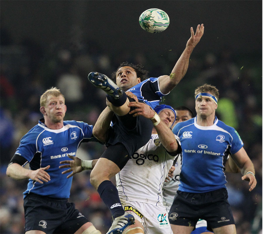 Leinster's Isa Nacewa is tackled by Clermont's Julien Pierre