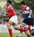 Sione Kalamafoni takes on the Korea defence