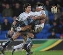Cardiff's Tom Slater tackles Aironi's Gabriel Pizarro