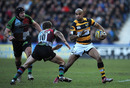 Wasps wing Tom Varndell takes on Quins fly-half Nick Evans