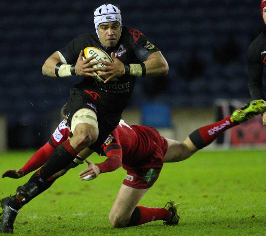 Edinburgh's Netani Talei steps past the tackle