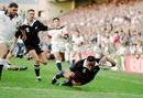 New Zealand's Jonah Lomu scores against England