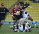 Saracens wing David Strettle is smashed by Seilala Mapusua