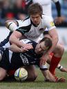 Saracens fly-half Owen Farrell tackles Sale's Charlie Hodgson