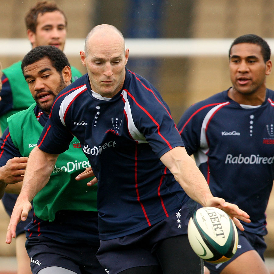 Melbourne Rebels centre Stirling Mortlock attempts to control the ball