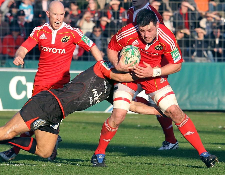 Munster's James Coughlan braces himself for a tackle