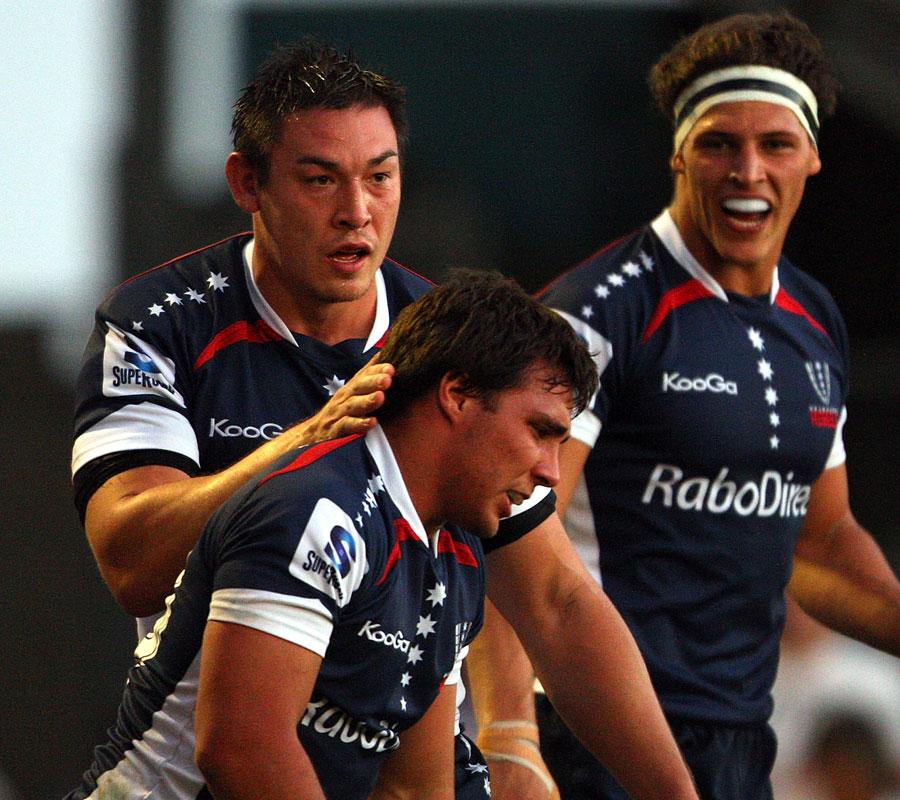 Melbourne Rebels No.8 Gareth Delve congratulates Nick Phipps on a try