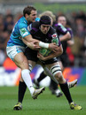 Ospreys' Ryan Jones shrugs off the tackle of Rory Lamont of Toulon