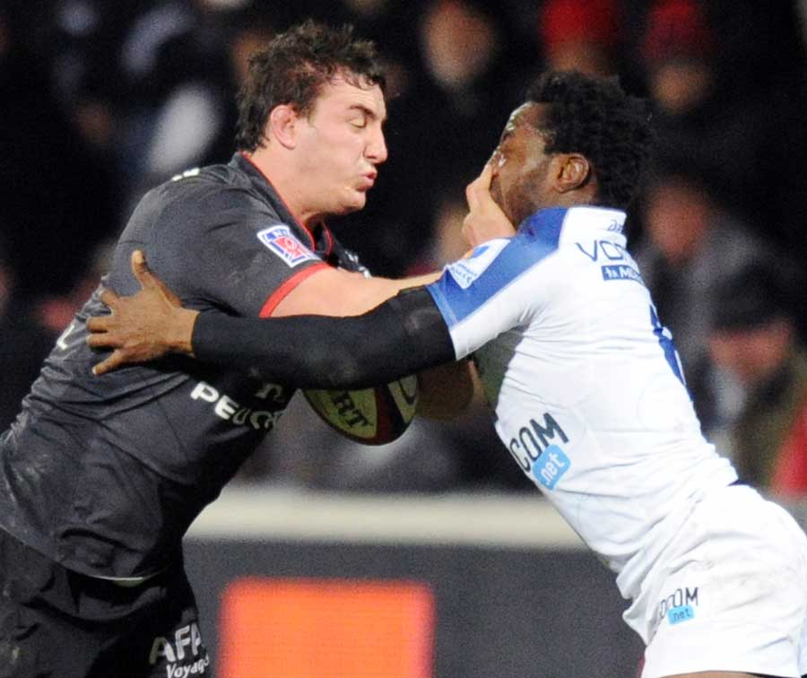 Toulouse's Louis Picamoles hands off Montpellier's Fulgence Ouedraogo