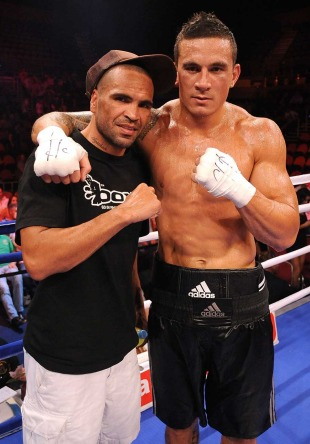 All Blacks centre Sonny Bill Williams and his trainer Anthony Mundine pose following his latest boxing bout, Gold Coast Convention and Exhibition Centre, Gold Coast, Australia, January 29, 2011