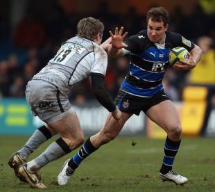 Bath's Olly Barkley prepares to fend off Newcastle's Luke Eves