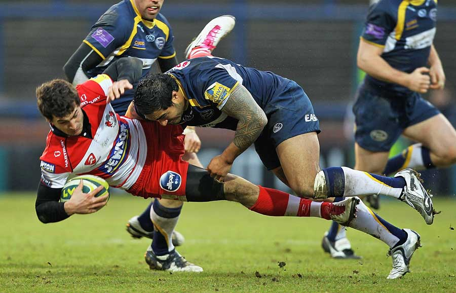 Gloucester's Jonny May is tackled by Leeds' Henry Fa'afili