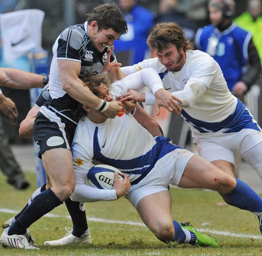 Scotland's Thom Evans tackles France's Cedric Heymans