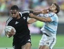 Frank Halai fends off Argentina's Ramiro Moyano during New Zealand's 34-7 win