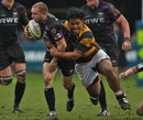 The Ospreys' Tom Isaacs is tackled by Wasps' Billy Vunipola