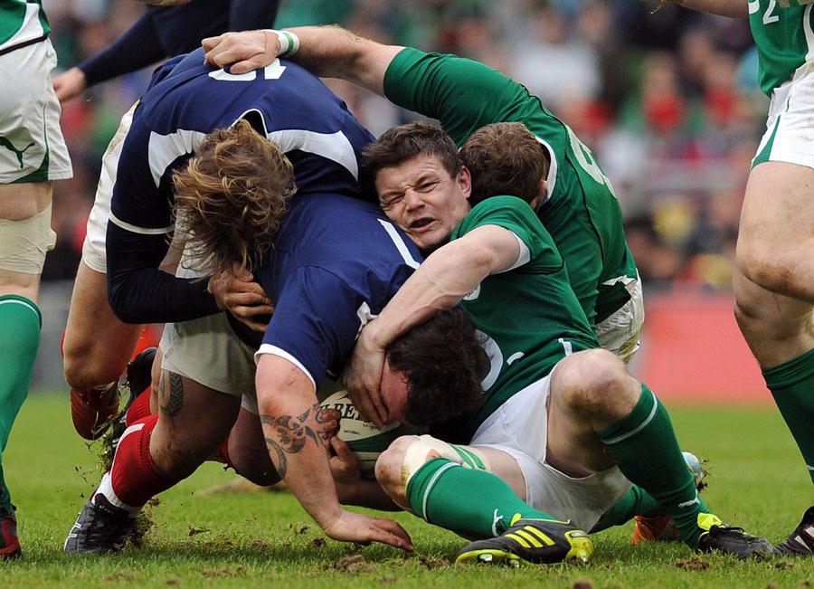 Ireland centre Brian O'Driscoll wrestles with Thomas Domingo