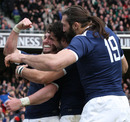 France wing Maxime Medard is mobbed after scoring