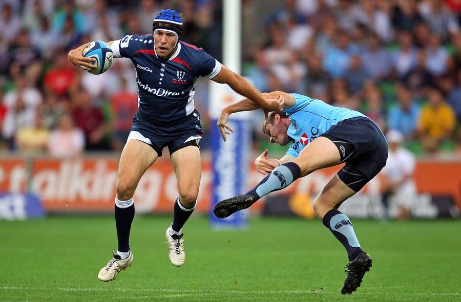 The Rebels' Julian Huxley evades a tackle