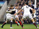France's Vincent Clerc is tackled by fellow wing Mark Cueto