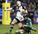 Harlequins' Mike Brown is hauled down by London Irish's George Stowers