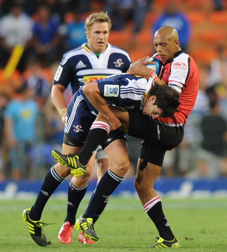 The Lions' Lionel Mapoe is stopped by Jaque Fourie of the Stormers