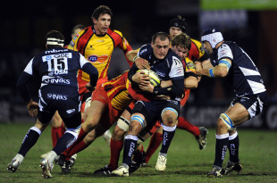 Sale's Carl Fearns is held up by the Dragons defence, Sale Sharks v Newport Gwent Dragons, Anglo-Welsh Cup, Edgeley Park, Stockport, England, January 28, 2011