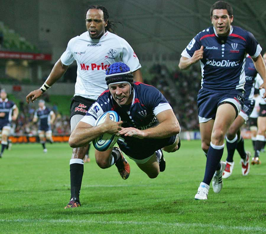 The Rebels' Julian Huxley dives over to score a try