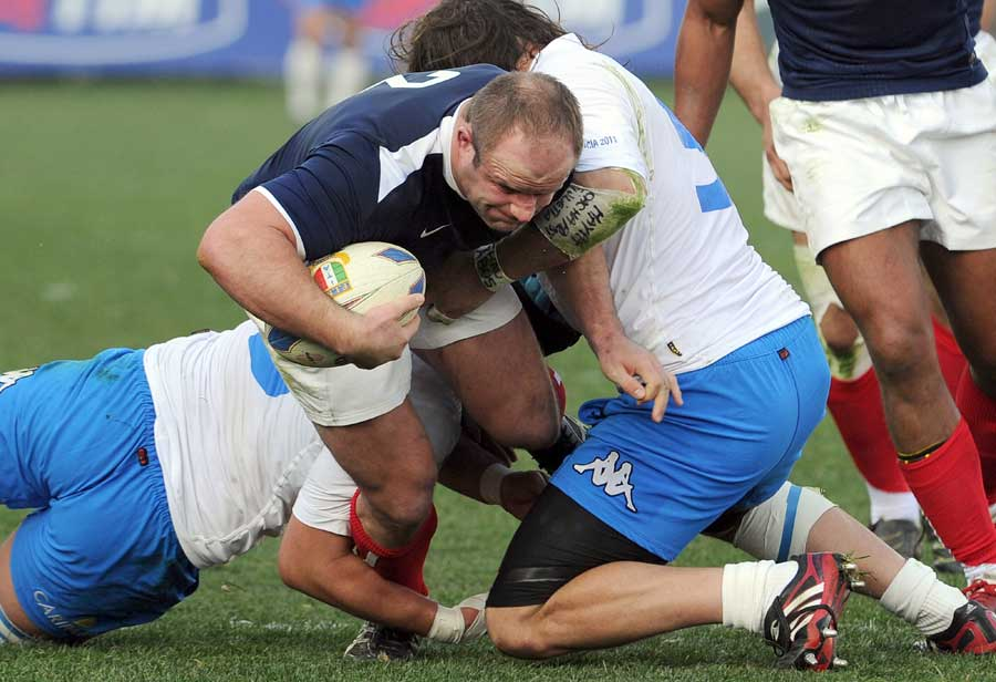 France hooker William Servat breaks a tackle