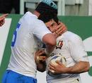 Italy fullback Andrea Masi celebrates a try