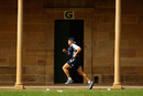 Waratahs skipper Phil Waugh runs during training