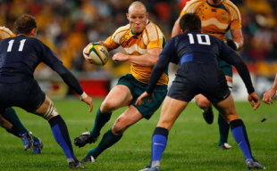 Wallabies captain Stirling Mortlock runs the ball during the second Bundaberg Rum Series test match between the Australian Wallabies and France at Suncorp Stadium on July 5, 2008 in Brisbane, Australia