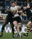 Matt Mustchin, of Edinburgh, tries to break through Wasps defence