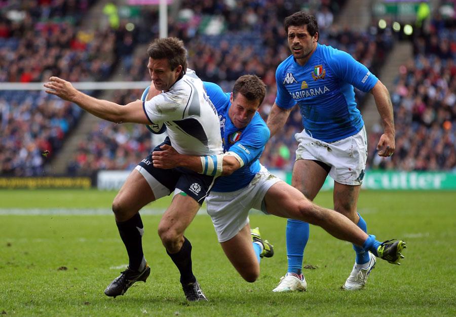 Scotland winger Simon Danielli is halted short of the Italian line
