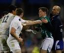 Ireland fly-half Ronan O'Gara faces up to England's Chris Ashton and Shontayne Hape