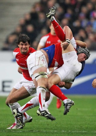 Wales' Dan Lydiate tackles France's Morgan Parra