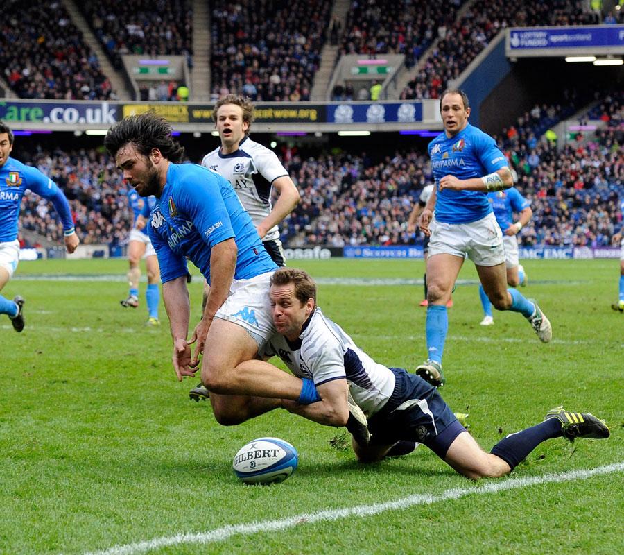 Scotland fullback Chris Paterson chops down Luke McLean