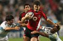 Canada's Ciaran Hearn breaks through an Argentinian tackle