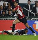 Japan's Latuila Lepuha breaks away to score against the USA