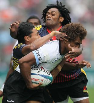 Fiji's Osea Kolinisau is collared by the Malaysian defence, IRB Sevens World Series, Hong Kong Stadium, Hong Kong, March 25, 2011