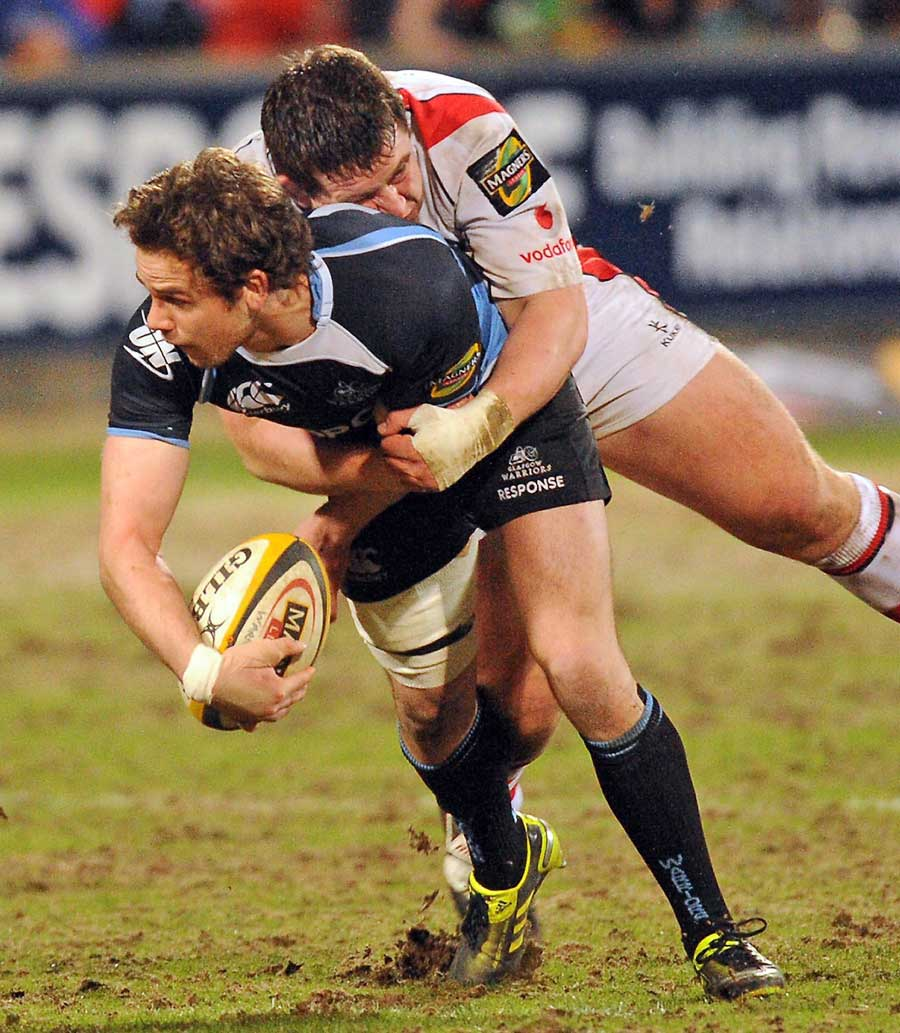 Glasgow's' Ruaridh Jackson is tackled by Ulster's Craig Gilroy