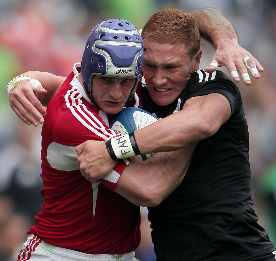 New Zealand's Declan O'Donnell and Frederico Oliveira of Portugal clash at the Hong Kong Sevens