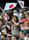 Japanese fans raise the flag at the Hong Kong Stadium