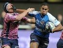 Montpellier's Seta Tuilevuka hands off Stade Francais' Remi Bonfils