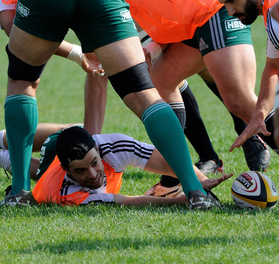Aironi fly-half James Marshall places the ball